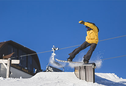 snowboarder sliding on a rail