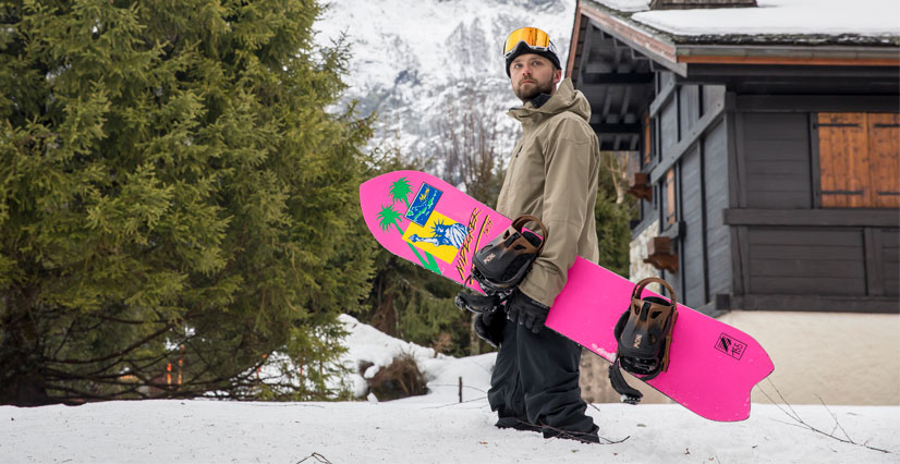 A man carrying a snowboard