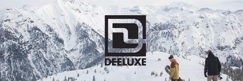 Deeluxe logo with snowboarders