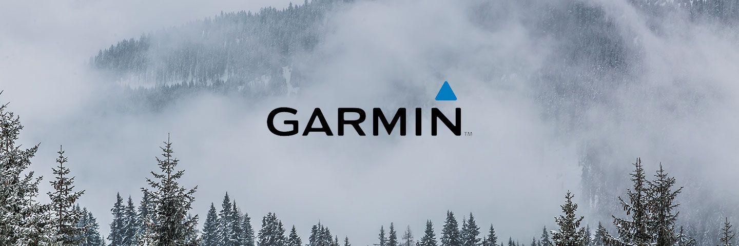 Garmin logo with misty forest scene in the background