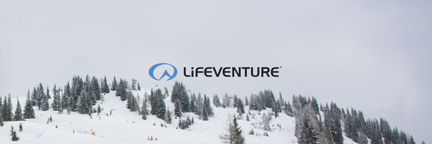 Lifeventure logo with snowy forest behind