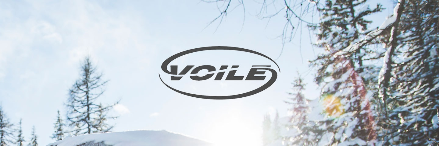Voile logo with wintry trees in background