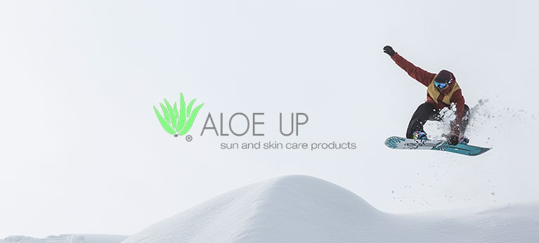 Aloe up logo with snowboarder in background