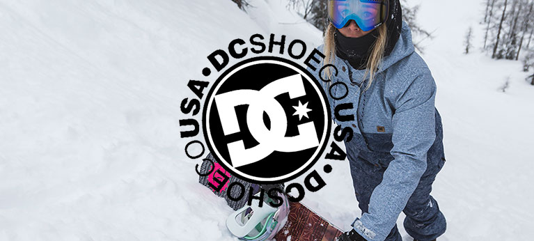 DC logo with snowboarder in background