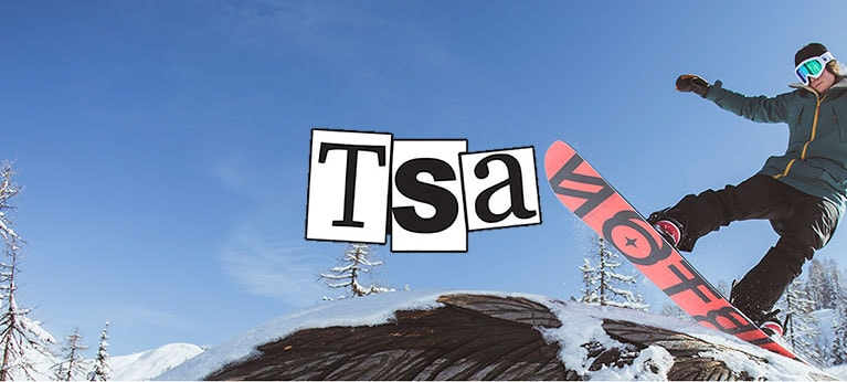 TSA Clothing logo with snowboarder doing tricks under blue sky in background