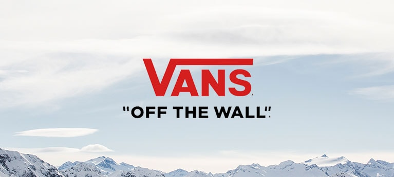 Vans logo with snowy mountain tops in background
