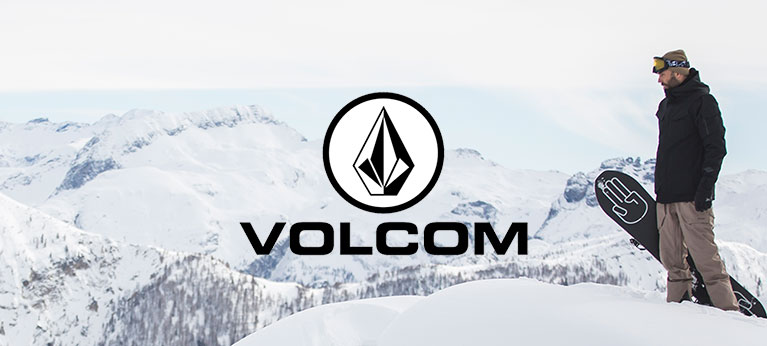 Volcom logo snowy mountain scene with snowboarder