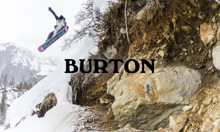 A cliff drop on a snowboard