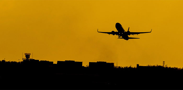 A airplane silhouette at sunset