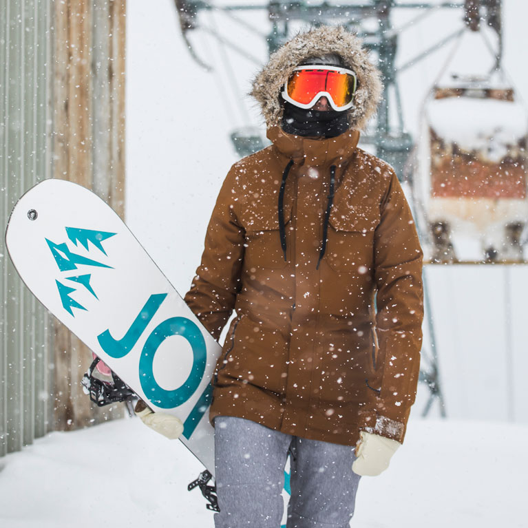 Snowboarder holding a snowboard