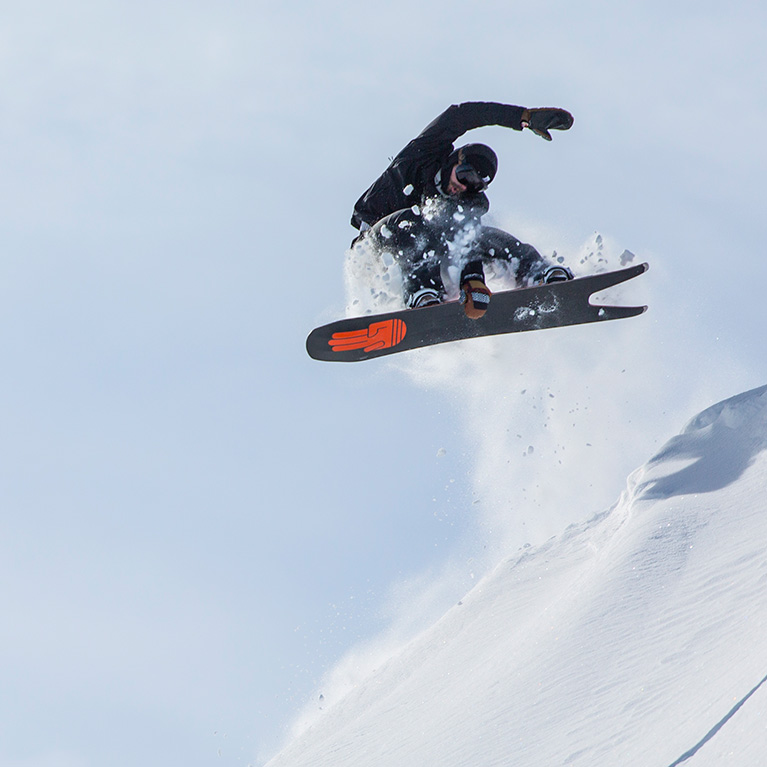 Man getting air on a snowboard
